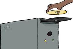 Main insérant le disque compact-ROM Images libres de droits