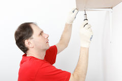 Main installing the shelf Stock Image