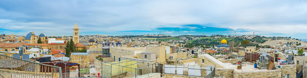 The main Jerusalem's sites. Panorama covers the wide view from the dome of the Holy Sepulchre Church to the golden cupola of the Dome of the Rock and the Mount Royalty Free Stock Photo