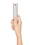 Main jugeant une TV à télécommande Photo libre de droits