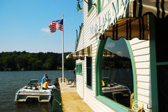 Main Lake Market, Lake Hopatcong, NJ. A boat docks at the Main Lake Market along Lake Hopatcong, New Jersey Royalty Free Stock Images