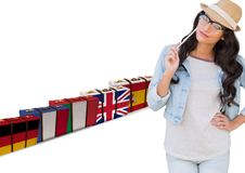 Main language flag suitcases behind young woman with hat. Royalty Free Stock Photo