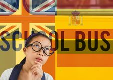 main language flags around girl. School bus background royalty free stock photos