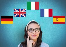 main language flags around young woman with glasses. Blue background royalty free stock image
