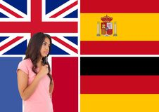 Main language flags around young woman with glasses on the hand Stock Photography