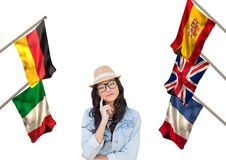Main language flags around young woman with hat Royalty Free Stock Photo