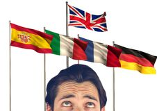 Main language flags behind foreground  of young man Royalty Free Stock Photos