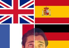 Main language flags and foreground of man looking up, overlap. Digital composite of main language flags and foreground of man looking up, overlap Royalty Free Stock Image