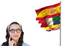Main language flags near young woman with glasses thinking Royalty Free Stock Photos