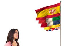 Main language flags near young woman looking it Royalty Free Stock Photography