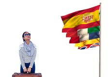 Main language flags near young woman with suitcase and sun glasses Stock Photos