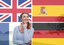 Main language flags overlap with field behind young woman imagining Royalty Free Stock Image