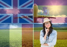 main language flags overlap with plane around young woman with hat thinking stock photos