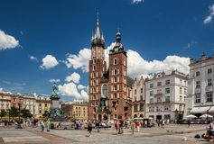 Main market and Basilica of Saint Mary Church of Our Lady Assumed into Heaven also known as Saint Mary`s Church. Cracow in Poland Stock Photography