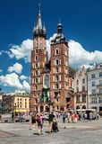 Main market and Basilica of Saint Mary Church of Our Lady Assumed into Heaven also known as Saint Mary`s Church. Cracow in Poland Royalty Free Stock Image