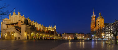 Main Market Square Krakow. Panoramic view on the the Main Market Square in Krakow at night with Mary´s Church and the Cloth Halls Stock Photo