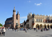 Main Market Square (Rynek) in Krakow, Poland. Main Market Square (Rynek) in Cracow, Poland, with Gothic Saint Maria (Mariacki) church, Renaissance drapers stock images