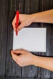 Main masculine écrite sur le cadre Photographie stock libre de droits