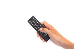 Main masculine jugeant la boîte supérieure TV à télécommande sur le Ba blanc Image stock