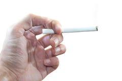 Main masculine tenant une cigarette Images stock