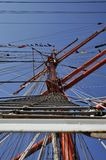 The main mast of the Sedov tall ship. Port Ijhaven, Amsterdam, the Netherlands - August 22, 2015: The climbing ladder on the main mast of the Sedov tall ship ( Stock Photography