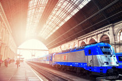 The main metro station Keleti with blue train and passengers. Budapest ,Hungary. The main metro station Keleti with blue train and passengers.Sunlight. Budapest royalty free stock photo