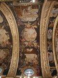 The main nave ceiling in the St John Co Cathedral, Valletta, Malta. The main nave with arched ceiling painted by Mattia Preti and gilded columns and marble floor royalty free stock images