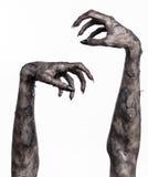Main noire de la mort, la marche complètement, thème de zombi, thème de Halloween, mains de zombi, fond blanc, mains de maman Image libre de droits