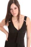 Main noire de robe sur le gratte-cul Images libres de droits