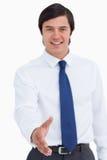 Main offerte par le jeune marchand de sourire Images libres de droits