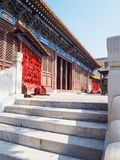 Main pavillon of the Confucian temple in Tianjin, China. With a rack full oh wishing cards outside Stock Images