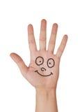 Main peinte avec le sourire d'isolement sur le blanc photos stock