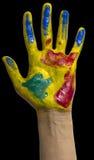 Main peinte. Fond noir Images libres de droits