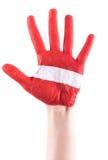 Main peinte par rouge avec la rayure blanche Photo stock