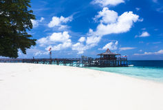 Main pier and white sand beach on Pulau Sipadan island near Borneo stock photo