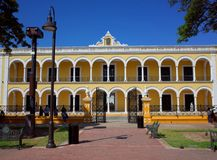 The main plaza of Campeche. With the yellow Cultural Palace royalty free stock images