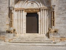 Main portal of the Collegiate church of San Quirico, Tuscany Royalty Free Stock Photography
