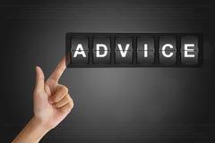 Main poussant le conseil sur Flip Board Photo stock
