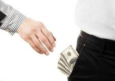 Main prenant l'argent de la poche Photographie stock libre de droits