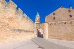 Main public access to Burgo de Osma medieval town. With public street and tower of cathedral, landmark and monument from thirteenth century, in Soria, Spain Royalty Free Stock Photos