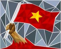 Main puissante soulevant le drapeau du Vietnam Image stock