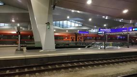 Main railway station pan left to right interior. Vienna, Austria - December 20, 2016: Main railway station of Vienna Wien Hauptbahnhof pan left to right interior stock footage