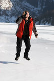 Main in red with photo jumping on winter lake Royalty Free Stock Images