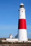 Main red and white lighthouse on Portland near Weymouth in Dorse. Main and active red and white lighthouse on Portland Island near Weymouth in Dorset in the royalty free stock photos