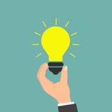 Main retenant l'ampoule Conception plate de style Image stock
