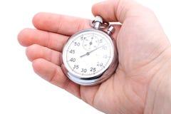 main retenant le chronomètre mechnical Photo libre de droits