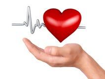 Main retenant le coeur rouge Concept de soins de santé et de médecine Photos libres de droits