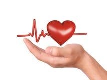Main retenant le coeur rouge Concept de soins de santé et de médecine Photo libre de droits