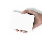 Main retenant le livre blanc Photographie stock libre de droits