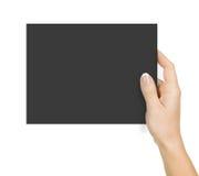 Main retenant le papier photos stock
